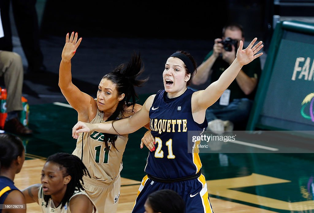Katherine Plouffe #21 of the Marquette Golden Eagles calls for the ball as Caitlin Rowe #11 of the South Florida Bulls defends during the game at the Sun Dome on January 26, 2013 in Tampa, Florida.
