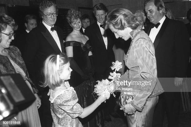 Katherine Reeve presents a bouquet to the Duchess of Gloucester at the Odeon Cinema Haymarket London The Duchess was attending the charity premiere...