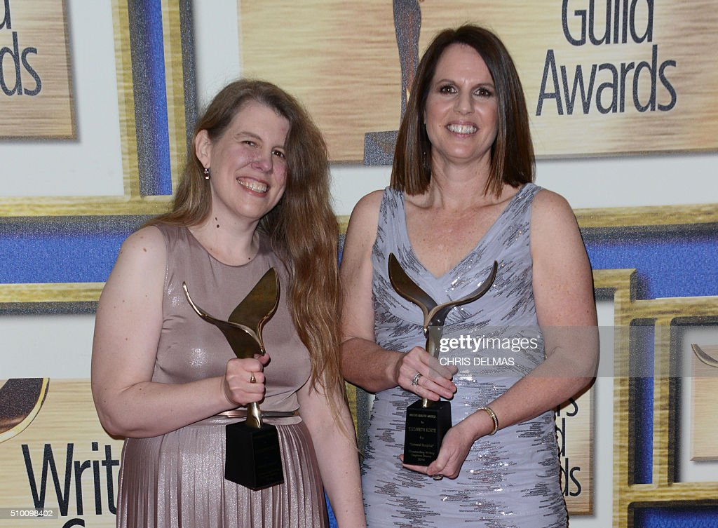 Katherine Shock and Elizabeth Korte poses in the press room at the Writers Guild Awards, in Century City, California, February 13, 2016. / AFP / CHRIS DELMAS