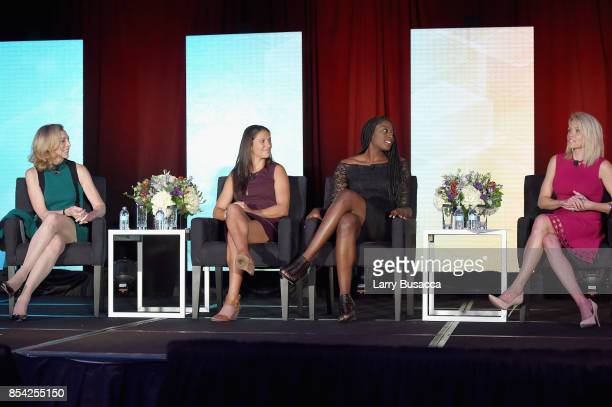 Katherine Switzer Carli Lloyd Chiney Ogwumike and Lisa Kerney speak onstage during the WICT Leadership Conference at Marriott Marquis Times Square on...
