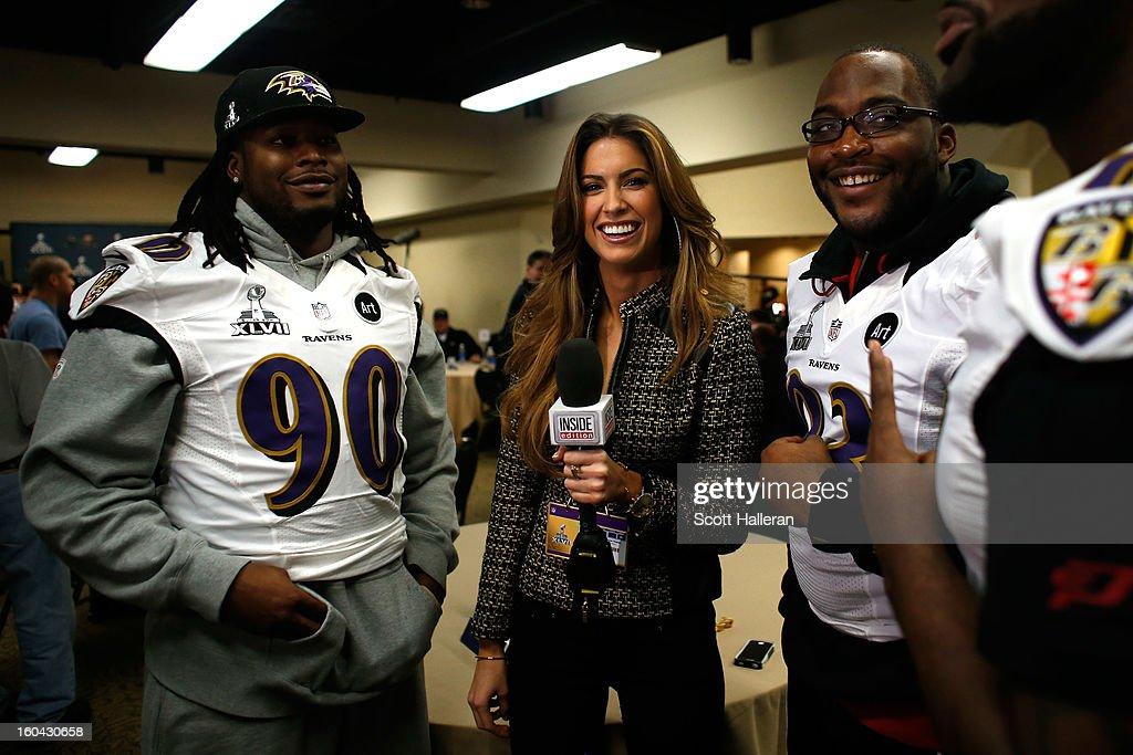 Katherine Webb of 'Inside Edition' interviews Pernell McPhee and DeAngelo Tyson during Super Bowl XLVII Media Availability at the Hilton New Orleans...