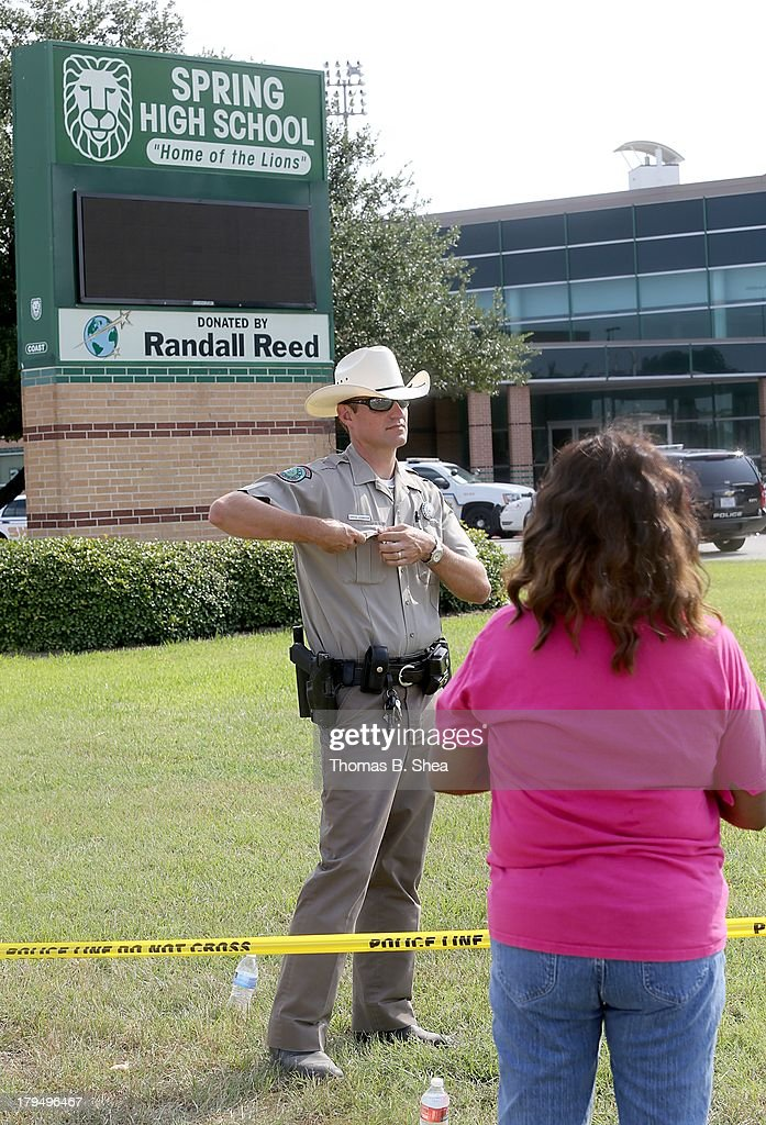 Katherine Womack who has two grandchildren attending Spring High School, tries to talk to an officer after a stabbing at Spring High School September 4, 2013 in Spring, Texas. A 17-year-old student was fatally stabbed and three other students during what has been reported as a fight at the school about 7:00 am. Three people have been taken into custody.