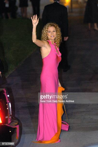 Kathie Lee Gifford waves as she arrives at the Episcopal Church of BethesdabytheSea in Palm Beach Fla to attend the wedding of billionaire Donald...