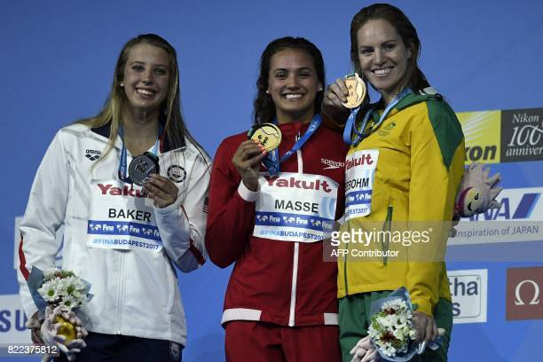 US Kathleen Baker Canada's Kylie Jacqueline Masse and Australia's Emily Seebohm celebrate on the podium after the women's 100m backstroke final...