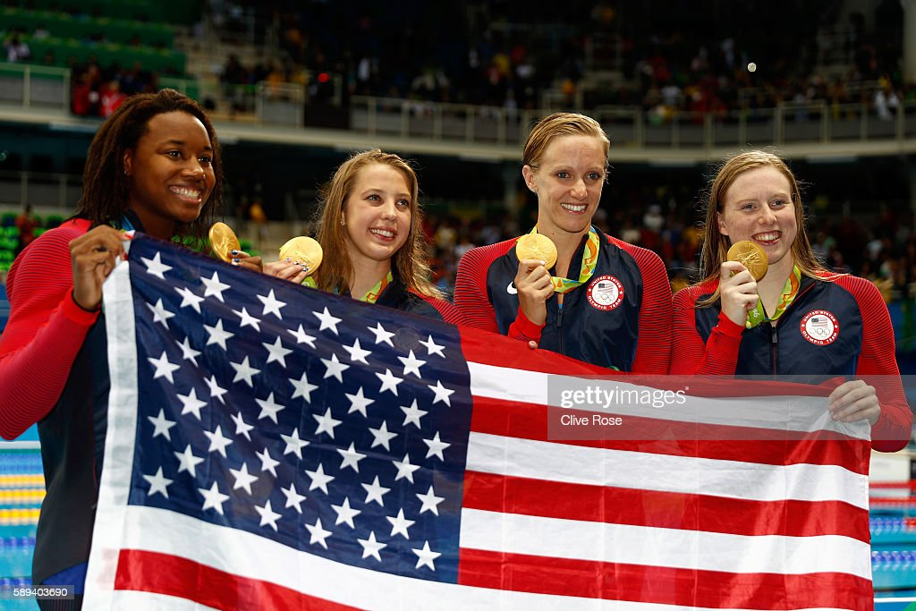 Kathleen Baker Lilly King Dana Vollmer Simone Manuel of the United States pose during the medal ceremony for the Women's 4 x 100m Medley Relay Final...