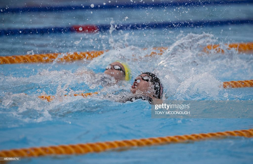 <a gi-track='captionPersonalityLinkClicked' href=/galleries/search?phrase=Kathleen+Baker+-+Swimmer&family=editorial&specificpeople=16070529 ng-click='$event.stopPropagation()'>Kathleen Baker</a> of the US powers forward in the women's 100m backstroke event on day two of the Aquatic Super Series swimming competition in Perth on January 31, 2015. AFP PHOTO / TONY McDONOUGH IMAGE