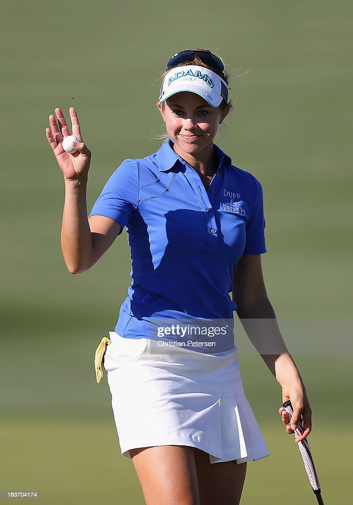 Kathleen Ekey reacts to fans after a birdie putt on the 15th hole green during the first round of the RR Donnelley LPGA Founders Cup at Wildfire Golf Club on March 14, 2013 in Phoenix, Arizona.
