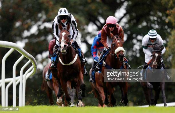 Kathleen Frances ridden by Jack Doyle leads eventual winner Magic Monkey ridden by Jason Maguire in the UK Forest Products Association Maresacute...