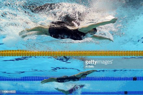 Kathleen Hersey of the United States and Natsumi Hoshi of Japan compete in the Final of the Women's 200m Butterfly on Day 5 of the London 2012...