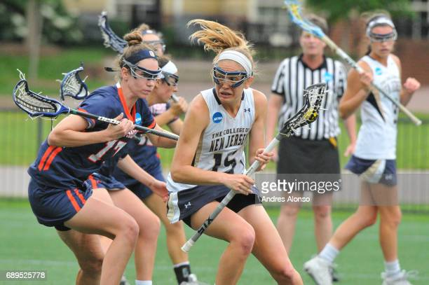 Kathleen Jaeger of College of New Jersey is stopped by Gettysburg College defenders during the Division III Women's Lacrosse Championship held at...