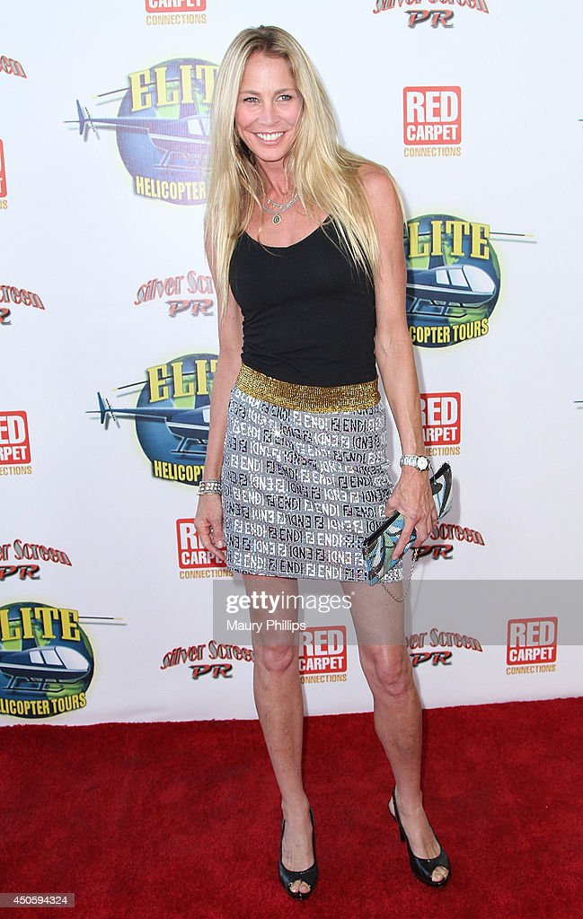 Kathleen Kinmont arrives at Lorenzo Lamas' New Business Elite Helicopter launch party at the Van Nuys Airport on June 13, 2014 in Van Nuys, California.