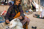 Kathleen Lama a homeless woman fusses over a stray dog Originally from Darjeeling she has now made her home on a patch of land in Nizamuddin Delhi...