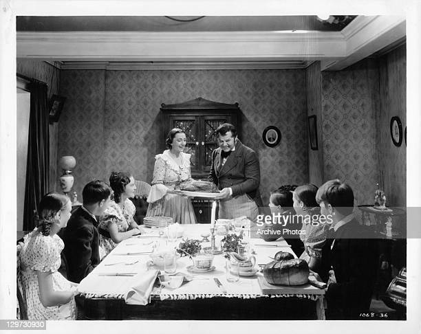 Kathleen Lockhart and Gene Lockhart present Christmas meal to family in a scene from the film 'A Christmas Carol' 1938