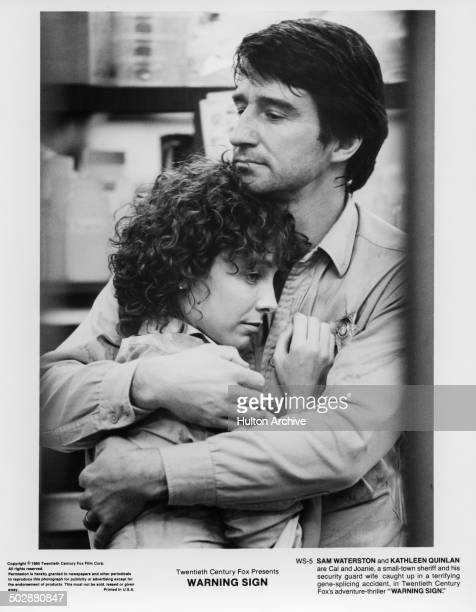 Kathleen Quinlan and Sam Waterston embrace in a scene for the 20th Century Fox movie 'Warning Sign' circa 1985