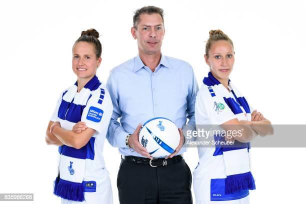 Kathleen Radtke and Yvonne Zielinski of MSV Duisburg pose with Allianz Insurance Manager Michael Schlagregen during the Allianz Frauen Bundesliga...