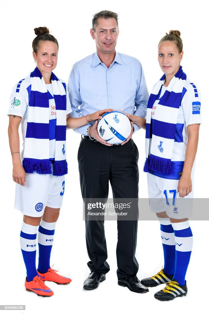 Kathleen Radtke (L) and Yvonne Zielinski (R) of MSV Duisburg pose with Allianz Insurance Manager Michael Schlagregen during the Allianz Frauen Bundesliga Club Tour at MSV Duisburg on August 17, 2017 in Duisburg, Germany.