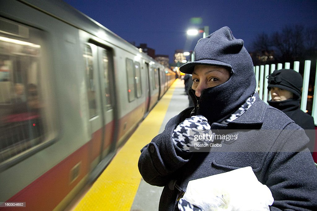 Kathleen Rivera, of Dorchester, waits to board the red line train after work as commuters wait on the platform for the red line at the MGH MBTA station in single-digit temperatures in Boston, Mass. on Thursday, January 3, 2013.