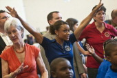 Kathleen Sebelius and Dominique Dawes participate with children duing the Active Play Video Game Demonstration at WalkerJones Education Campus on...