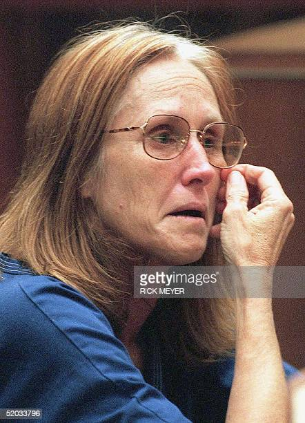Kathleen Soliah wipes a tear after her family was introduced by a defense attorney at a Los Angeles courthouse 14 July 1999 Soliah was arraigned and...