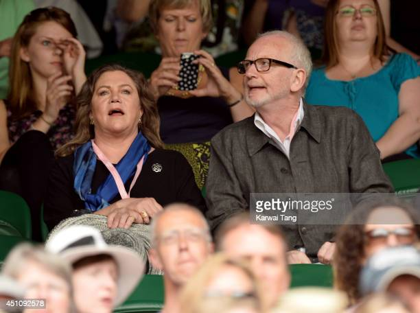 Kathleen Turner and Ian McDiarmid attend the Andy Murray v David Goffin match on centre court during day one of the Wimbledon Championships at...