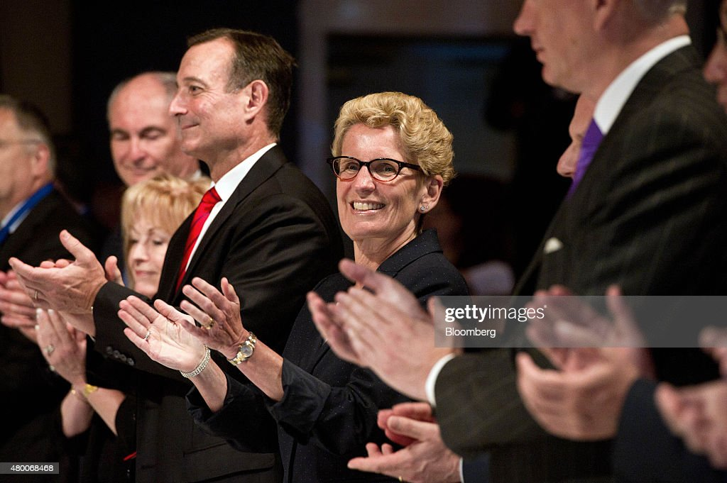 <a gi-track='captionPersonalityLinkClicked' href=/galleries/search?phrase=Kathleen+Wynne&family=editorial&specificpeople=10626599 ng-click='$event.stopPropagation()'>Kathleen Wynne</a>, premier of Ontario, applauds along with other members of the head table during the Toronto Global Forum in Toronto, Ontario, Canada, on Wednesday, July 8, 2015. The Toronto Forum is a platform to present opportunities for business synergies aimed at long term partnerships in the context of changing dynamics in the global economy. Photographer: Galit Rodan/Bloomberg via Getty Images