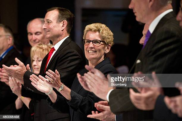 Kathleen Wynne premier of Ontario applauds along with other members of the head table during the Toronto Global Forum in Toronto Ontario Canada on...