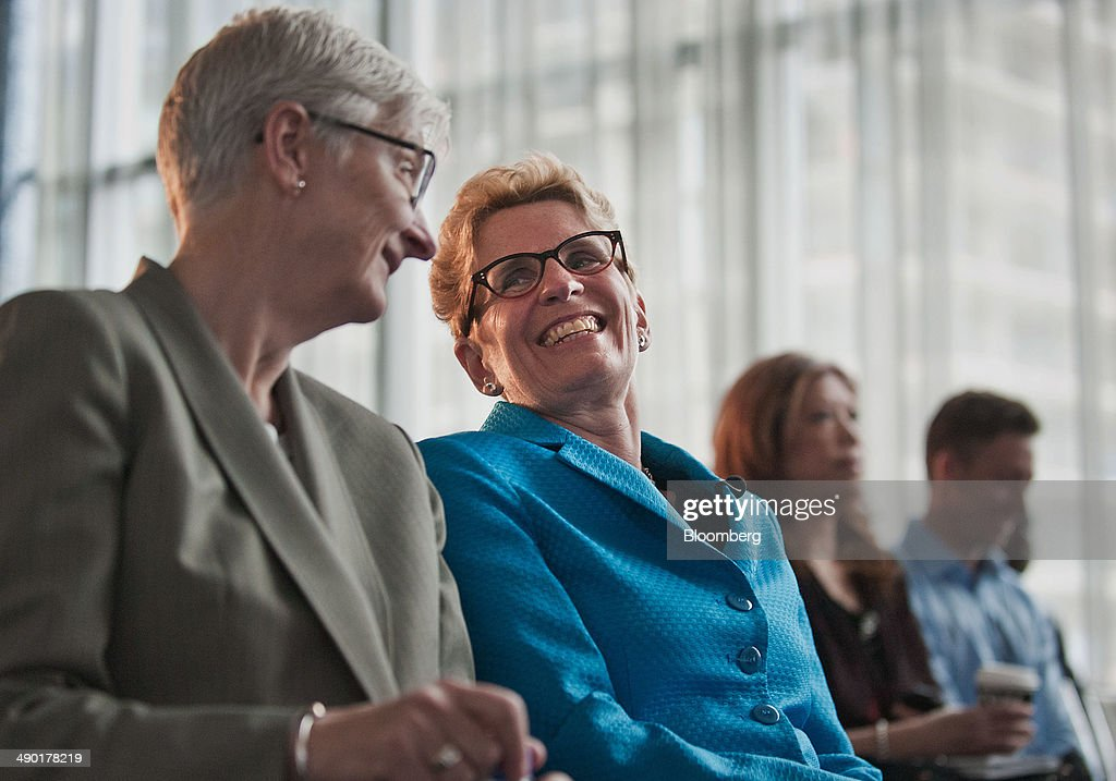 <a gi-track='captionPersonalityLinkClicked' href=/galleries/search?phrase=Kathleen+Wynne&family=editorial&specificpeople=10626599 ng-click='$event.stopPropagation()'>Kathleen Wynne</a>, premier of Ontario, center, shares a laugh with her partner Jane Rounthwaite, left, during the Bloomberg Economic Summit in Toronto, Ontario, Canada, on Tuesday, May 13, 2014. Wynne said next month's provincial election is a choice between austerity or economic growth. Photographer: Galit Rodan/Bloomberg via Getty Images <a gi-track='captionPersonalityLinkClicked' href=/galleries/search?phrase=Kathleen+Wynne&family=editorial&specificpeople=10626599 ng-click='$event.stopPropagation()'>Kathleen Wynne</a>; Jane Rounthwaite