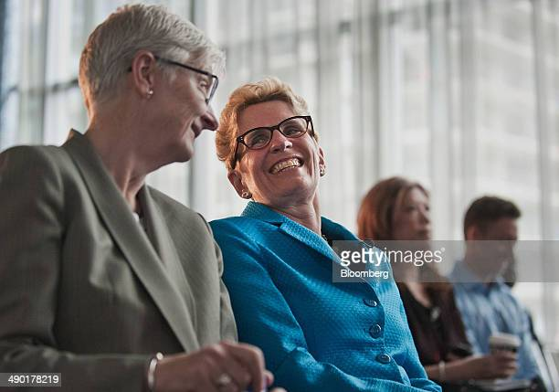 Kathleen Wynne premier of Ontario center shares a laugh with her partner Jane Rounthwaite left during the Bloomberg Economic Summit in Toronto...