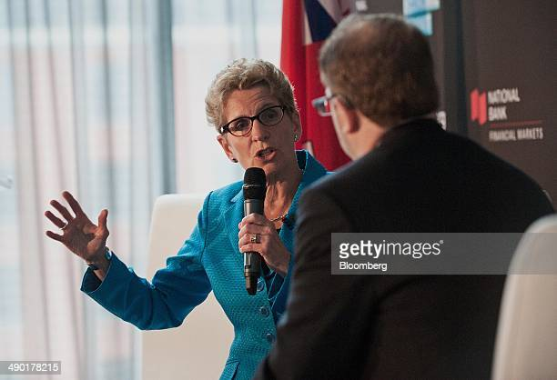 Kathleen Wynne premier of Ontario left speaks during the Bloomberg Economic Summit in Toronto Ontario Canada on Tuesday May 13 2014 Wynne said next...