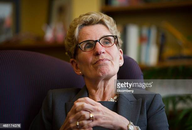 Kathleen Wynne premier of Ontario pauses while speaking during an interview at her Queen's Park office in Toronto Ontario Canada on Monday March 3...