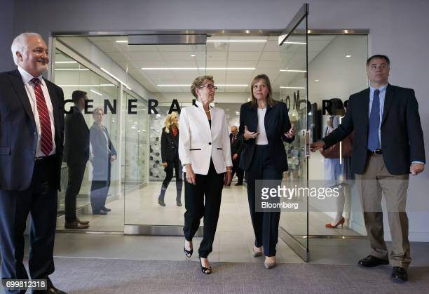 Kathleen Wynne premier of Ontario second left and Mary Barra chief executive officer of General Motors Corp second right exit after a meeting at the...