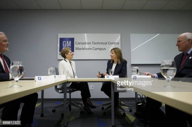Kathleen Wynne premier of Ontario second left and Mary Barra chief executive officer of General Motors Corp second right speak during a meeting at...