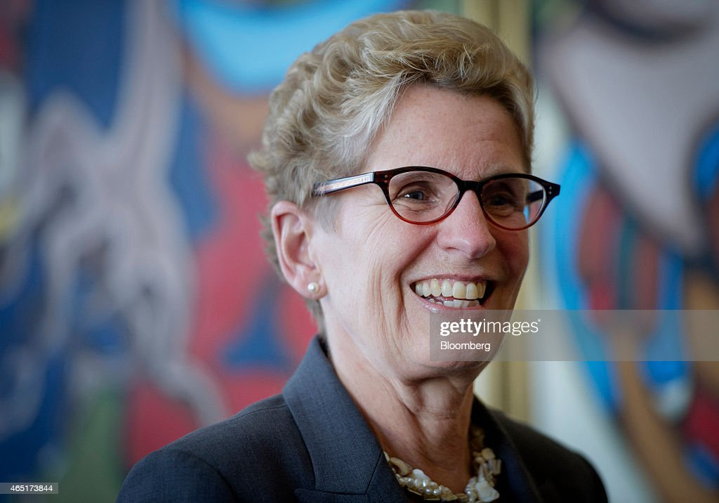<a gi-track='captionPersonalityLinkClicked' href=/galleries/search?phrase=Kathleen+Wynne&family=editorial&specificpeople=10626599 ng-click='$event.stopPropagation()'>Kathleen Wynne</a>, premier of Ontario, smiles during an interview at her Queen's Park office in Toronto, Ontario, Canada, on Monday, March 3, 2015. In January Wynne proposed the Canadian Infrastructure Partnership, a collaboration aimed at investing five percent of GDP in infrastructure renewal. Photographer: Kevin Van Paassen/Bloomberg via Getty Images