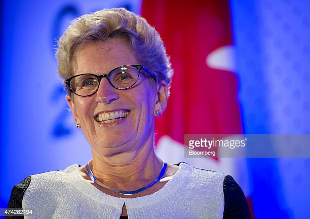 Kathleen Wynne premier of Ontario smiles during an interview at the Bloomberg Canada Economic Summit in Toronto Ontario Canada on Thursday May 21...