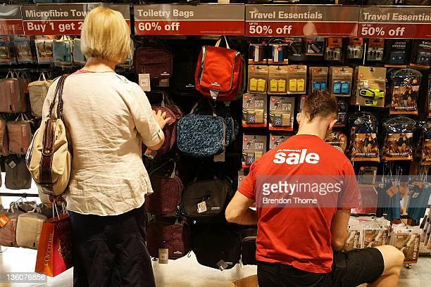 Kathmandu employee is seen wearing a sale shirt at the Kathmandu Kent Street store on December 23 2011 in Sydney Australia As retailers like...