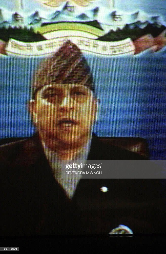 In this frame taken from television, Nepal's King Gyanendra addresses the nation in a broadcast aired in Kathmandu, 01 February 2006. Gyanendra marked the first anniversary of his takeover of power with a national address vowing local elections would go ahead next week despite threats of mass protests. His speech drew an angry response from the kingdom's political parties, which were sidelined by his power grab last year and have since aligned themselves with armed Maoist rebels trying to topple the monarchy.They warned the king was pushing the aid-dependent country further into chaos amid renewed bloodshed between government forces and the rebels, whose 10-year uprising has claimed more than 12,000 lives.