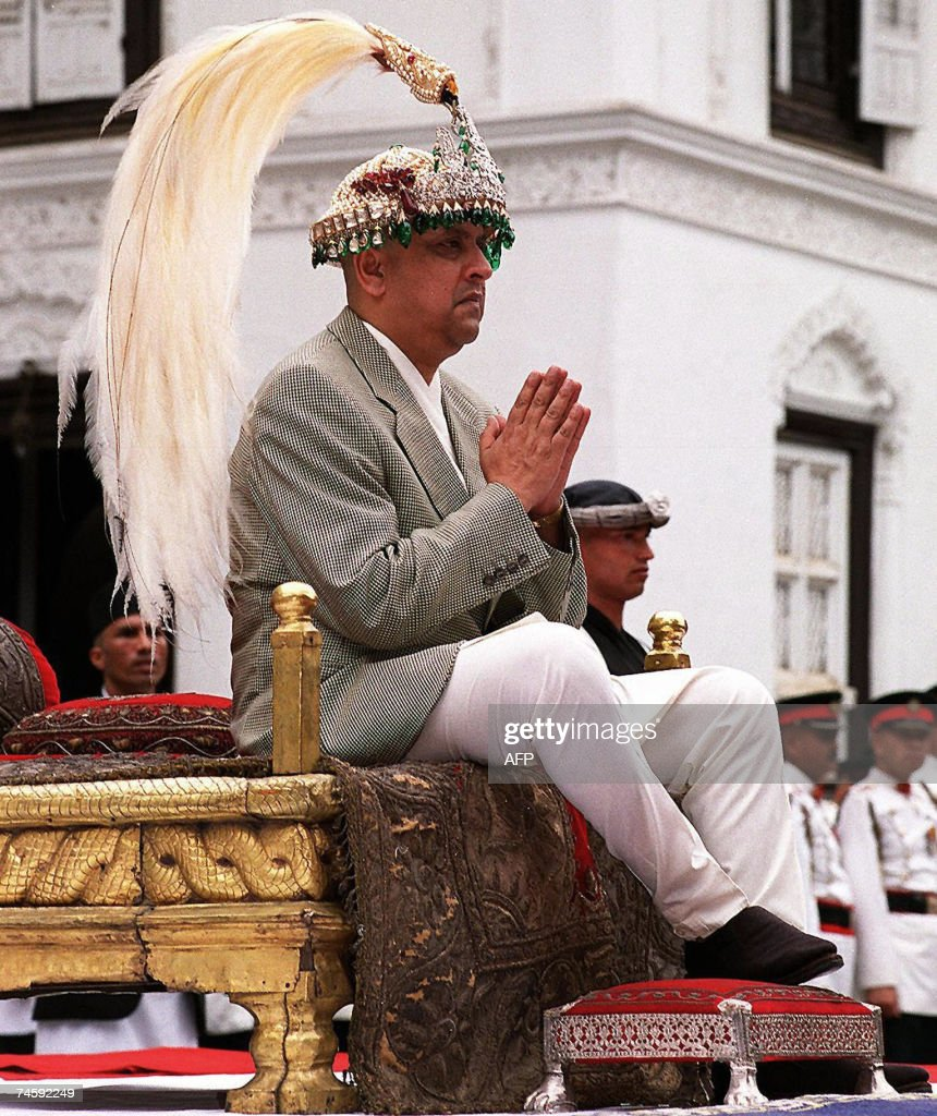 In this picture taken 04 June 2001, Nepal's King Gyanendra places his hands together in a traditional greeting after being crowned new King of Nepal in ancient Palace courtYard at Hanuman Dhoka in Kathmandu. Nepal's parliament has for the first time given itself powers to abolish the monarchy in a move that piles pressure on the already hobbled 238-year-old Shah dynasty, analysts said 14 June 2007. Legislators passed a constitutional amendment late 13 June 2007, that allows for the abolition of the monarchy by a two-thirds majority vote if King Gyanendra interferes in crucial elections planned for November 2007. Nepal's monarch has already been stripped of most of his powers, including his roles as head of state and army chief, since mass protests forced an end to a 14-month period of his authoritarian rule in April 2006. AFP PHOTO/Narendra SHRESTHA/FILES