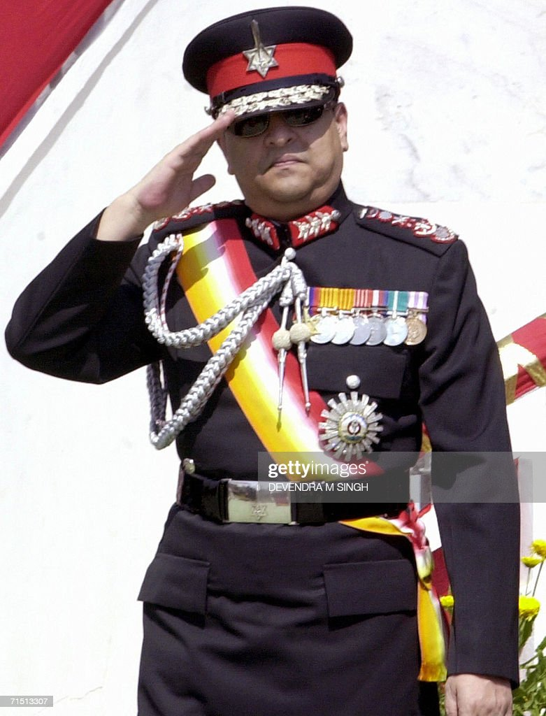 In this picture taken 08 March 2005, Nepal's King Gyanendra wears army uniform as he salutes the playing of the national anthem at a ceremony in Kathmandu. The reference to King Gyanendra and his 238-year-old dynasty are likely to be wiped from Nepal's anthem, oflficial and analysts said 25 July 2006. A total of 37 anthem proposals have been submitted to the Nepali government. Gyanendra was forced to reinstate parliament and end 14 months of often criticized direct rule after three weeks of mass protests in April 2006, organized by rebel Maoists in concert with sidelined political parties. The new government has removed the monarch's control over the Himalayan country's 90,000-strong army and pledged to form an interim government that will include the Maoists.