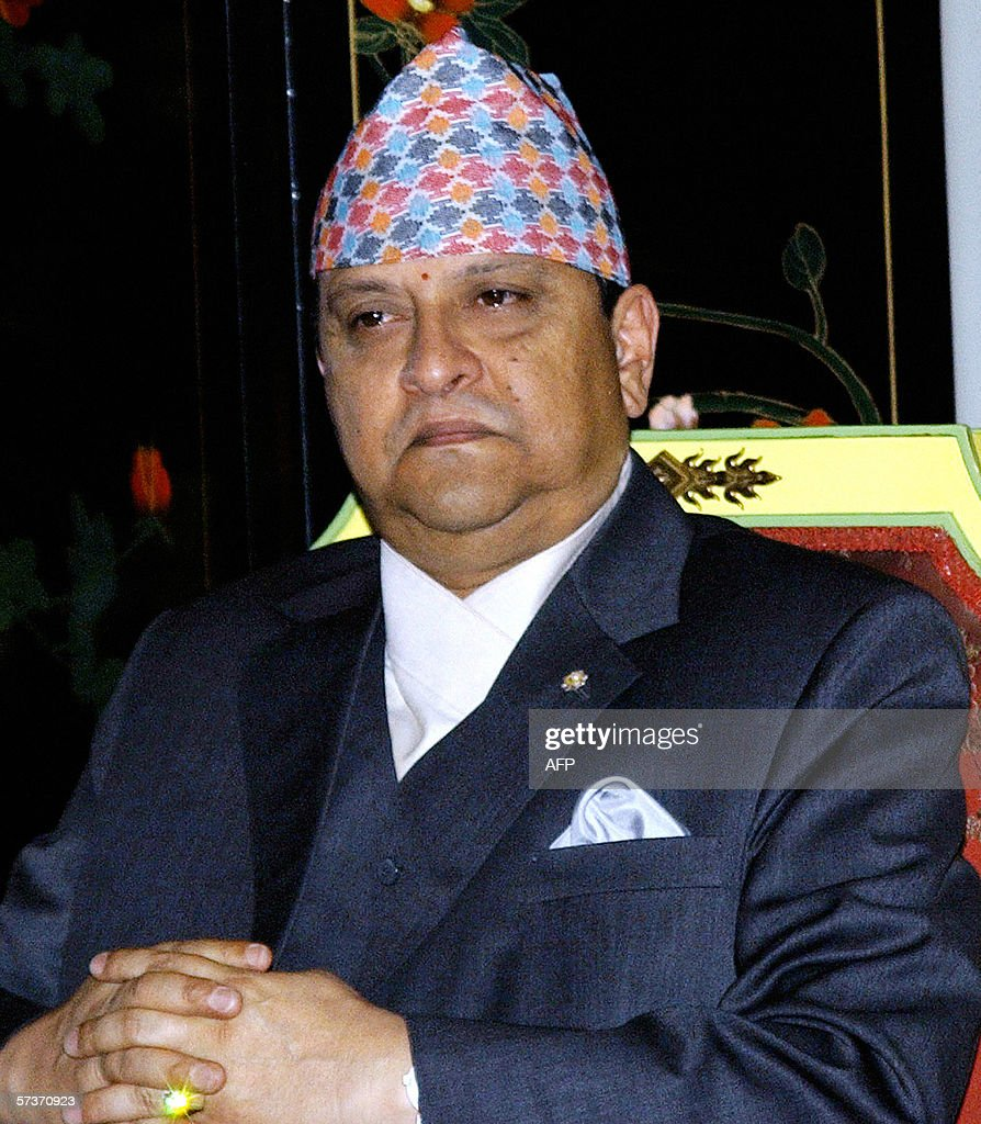 King Gyanendra of Nepal is pictured prior to granting an audience to the visiting Indian Prime Minister's Manmohan Singh's Special Envoy to Nepal, Karan Singh the Royal Palace in Kathmandu, 20 April 2006. Special Envoy Singh arrived in on 19 April to make a general assessment of the present political situation. Outside, large numbers of solders and police armed with shoot-on-sight orders enforced the curfew in a bid to thwart a planned mass rally marking the start of the third week of a general strike.