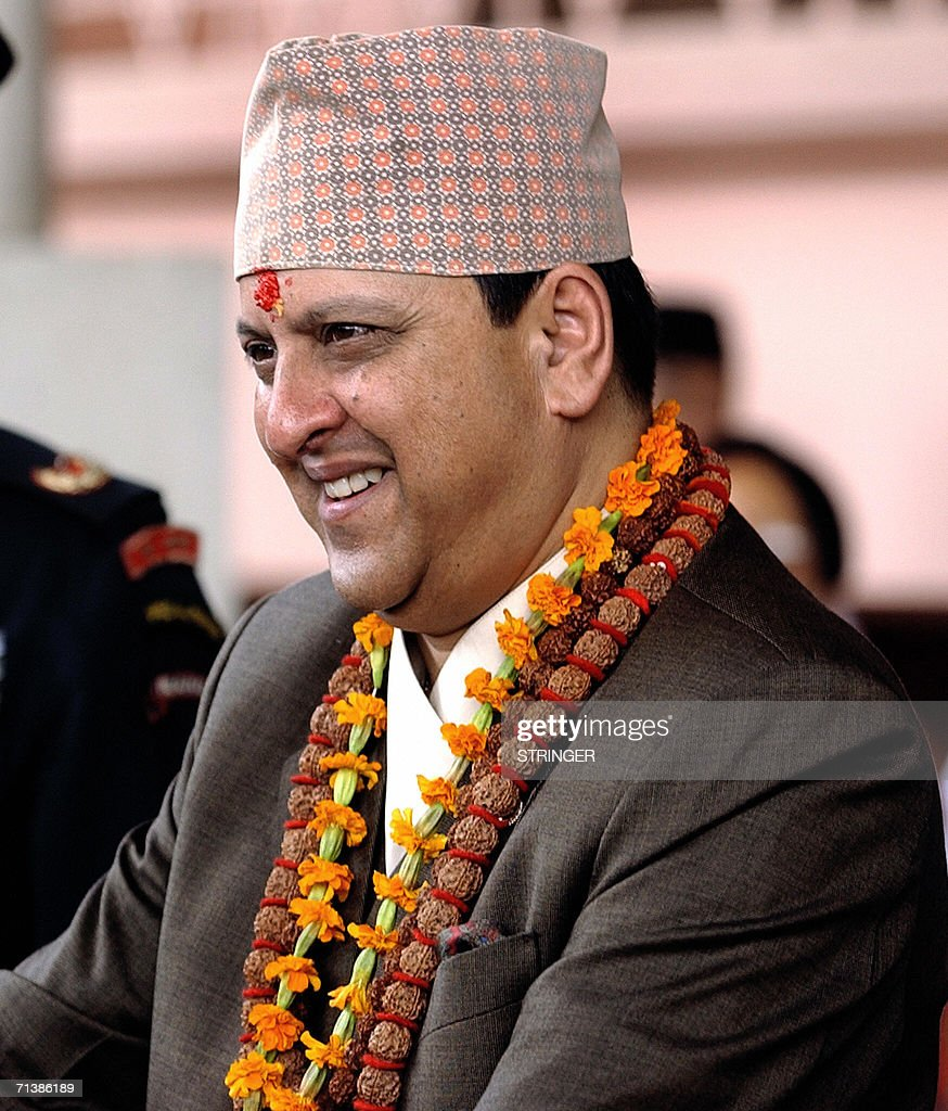 King Gyanendra of Nepal smiles on the auspicious occasion of the his 60th Birthday at Narayanhity Royal Palace in Kathmandu, 07 July 2006. Thousands of people lined up in front of the palace to greet the King as the new interim government scrapped the day as a national holiday after King Gyanendra was forced to end 14-months of direct rule after deadly street protests in April. AFP PHOTO/DEVENDRA M SINGH