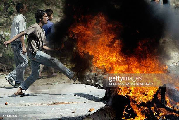 Nepalese pro democracy protestors shout slogans as they set up fiery roadblocks in the streets of Kathmandu 24 April 2006 Maoist rebels have called a...