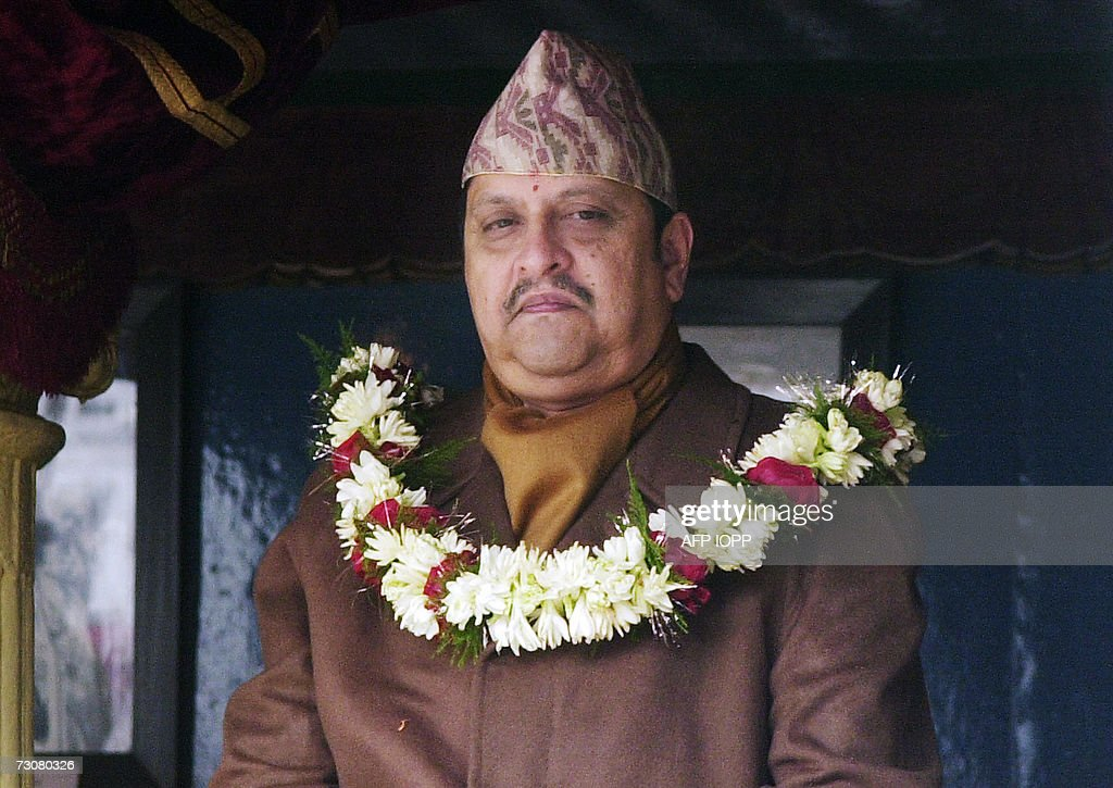 Nepal's sidelined King Gyanendra stands at a 16th century palace at Hanumandhoka on the occasion of Basanta Panchami, a Hindu festival which marks the advent of spring, in Kathmandu, 23 January 2007. King Gyanendra made a rare public appearance for a Hindu festival, his first outing since fiercely republican Maoists were admitted to parliament earlier this month. AFP PHOTO / DEVENDRA M SINGH