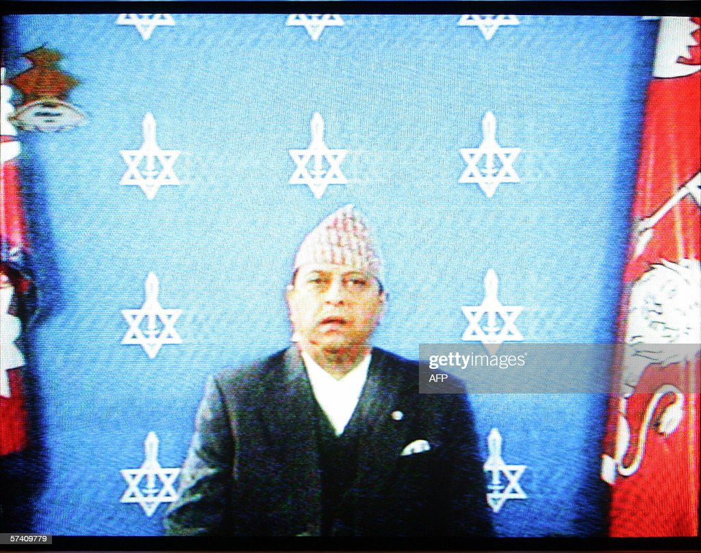 This television grab shows King Gyanendra of Nepal addressing the nation in Kathmandu 24 April 2006. King Gyanendra, buckling after 19 days of violent protests on the streets of the capital, agreed to reinstate the parliament that was dissolved in 2002. 'We declare the reinstatement of the House of Representatives,' he said a day before the opposition parties were to stage a huge rally in the capital Kathmandu demanding a return to multi-party democracy. King Gyanendra took absolute power after sacking the government in February last year saying it was corrupt and had failed to tackle a bloody 10-year Maoist insurgency. The move to restore parliament, a key demand of opposition parties leading the protests, would be effective from Friday, the king said. AFP PHOTO/Manan Vatsyayana