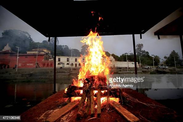 Kathmandu residents perform cremation rituals for their relatives killed in an earthquake at the Pashupatinath Temple in Kathmandu Nepal on May 03...