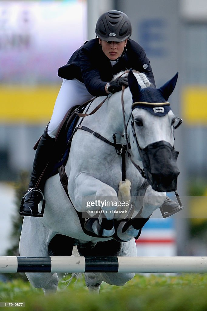 Kathrin Eckermann of Germany and her horse Carslon 46 compete in the RWE Prize of North-Rhine-Westphalia jumping competition during day four of the 2012 CHIO Aachen tournament on July 6, 2012 in Aachen, Germany.