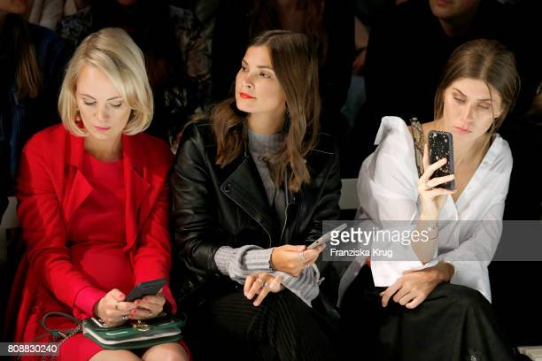 Kathrin Gelinsky Nina Schwichtenberg and Vicky Heiler attend the Marc Cain Fashion Show Spring/Summer 2018 at ewerk on July 4 2017 in Berlin Germany