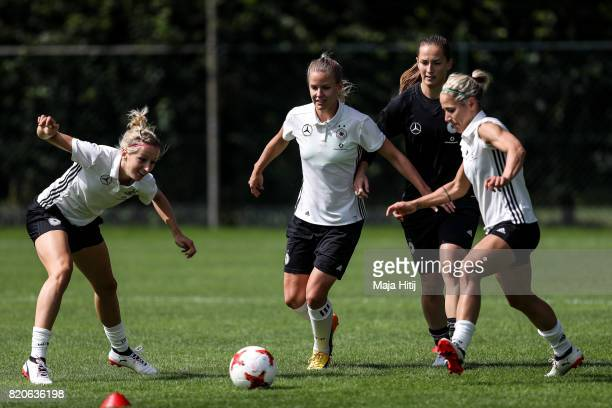 'SHERTOGENBOSCH NETHERLANDS JULY 22 Kathrin Hendrich Lena Petermann Laura Benkarth and Anna Blaesse battle for the ball during the training on July...