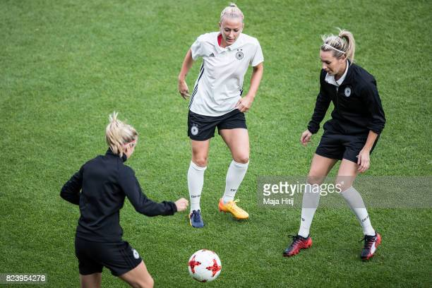 Kathrin Hendrich Mandy Islacker and Lena Goessling of Germany during a training prior the Quarter Final on July 28 2017 in Rotterdam Netherlands