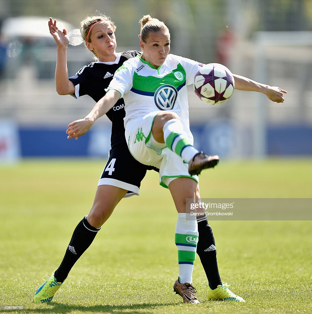 Kathrin Hendrich of 1. FFC Frankfurt challenges <a gi-track='captionPersonalityLinkClicked' href=/galleries/search?phrase=Isabel+Kerschowski&family=editorial&specificpeople=657233 ng-click='$event.stopPropagation()'>Isabel Kerschowski</a> of VfL Wolfsburg during the UEFA Women's Champions League Semi Final second leg match between 1. FFC Frankfurt and VfL Wolfsburg at Stadion am Brentanobad on May 1, 2016 in Frankfurt am Main, Germany.