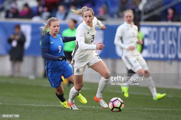 Kathrin Hendrich of Germany challenged by Eugénie Le Sommer of France during the France Vs Germany SheBelieves Cup International match at Red Bull...